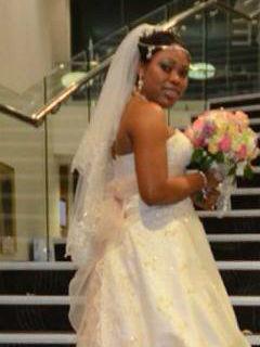 beautiful in her elaborate champagne wedding dress