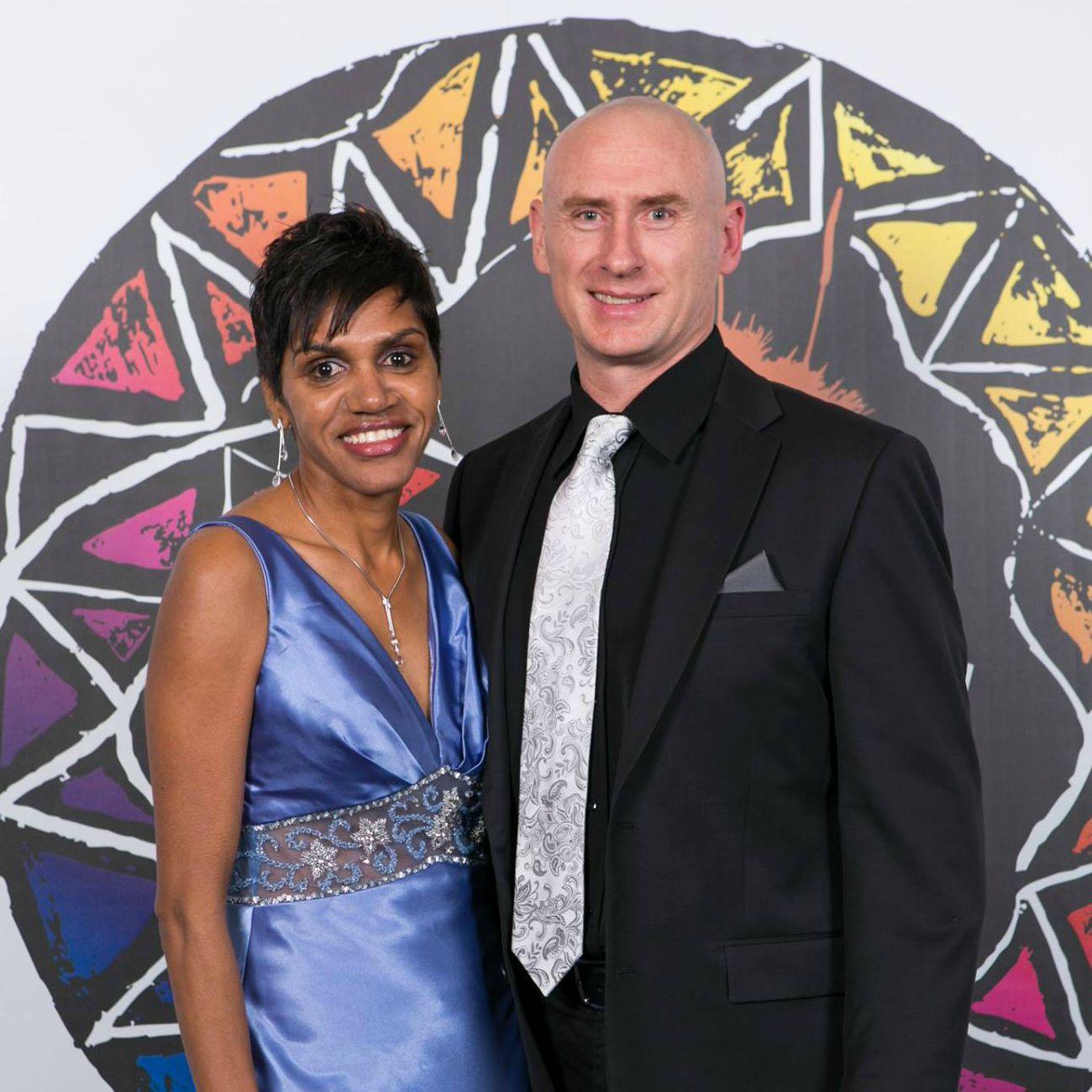 happy customer posing at a gala event