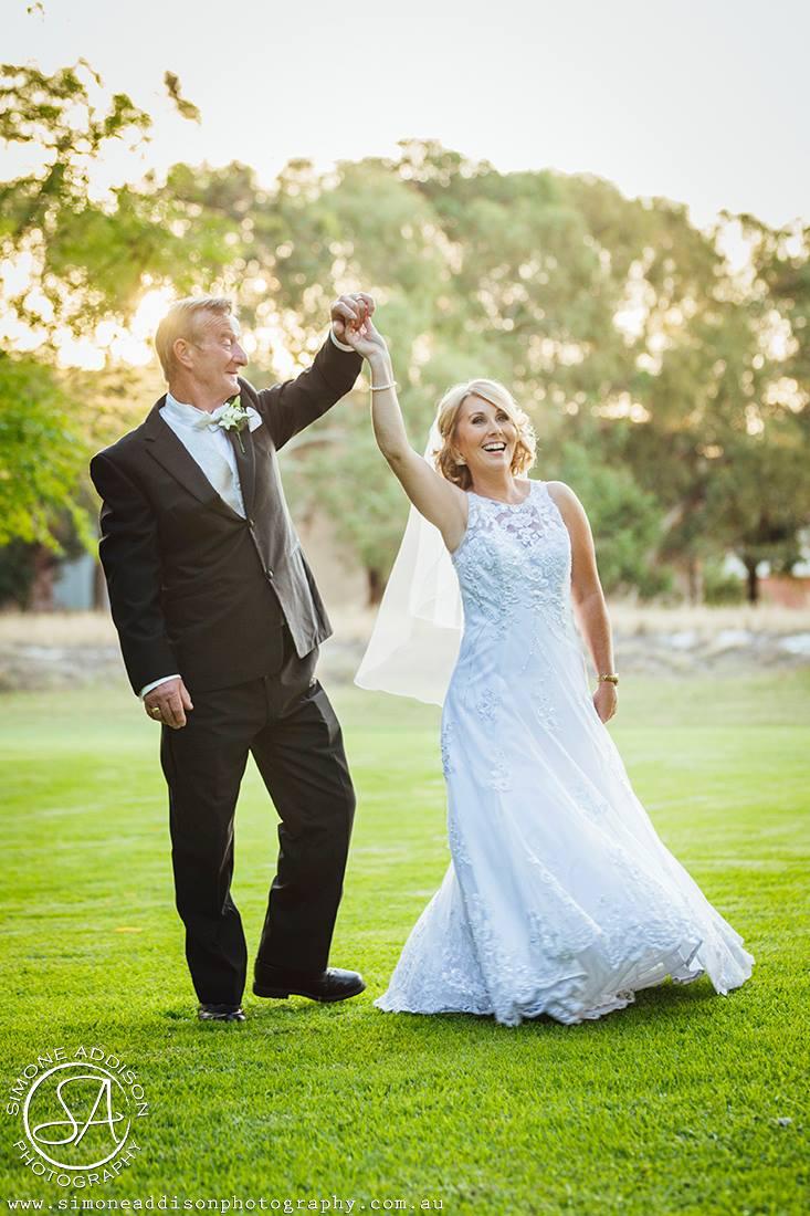 happy bride waltzing in her wedding dress