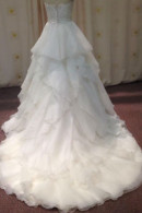 Graceful wedding gown with train