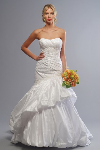 This taffeta wedding dress with dipped neckline asymmetric pleated bodice narrowing your waistline with artistically arranged tier skirt giving the illusion of height.