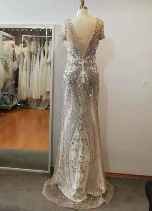 AnneMarie heavily beaded cap sleeves low V back wedding dress